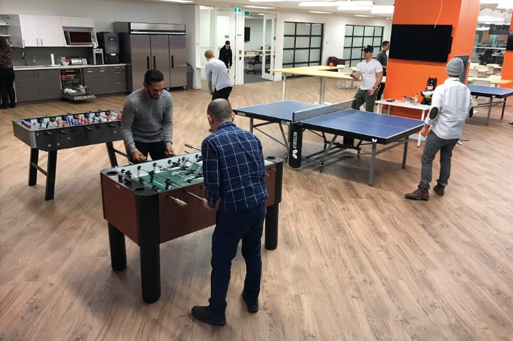 Hockeystick team at OneEleven space playing ping pong